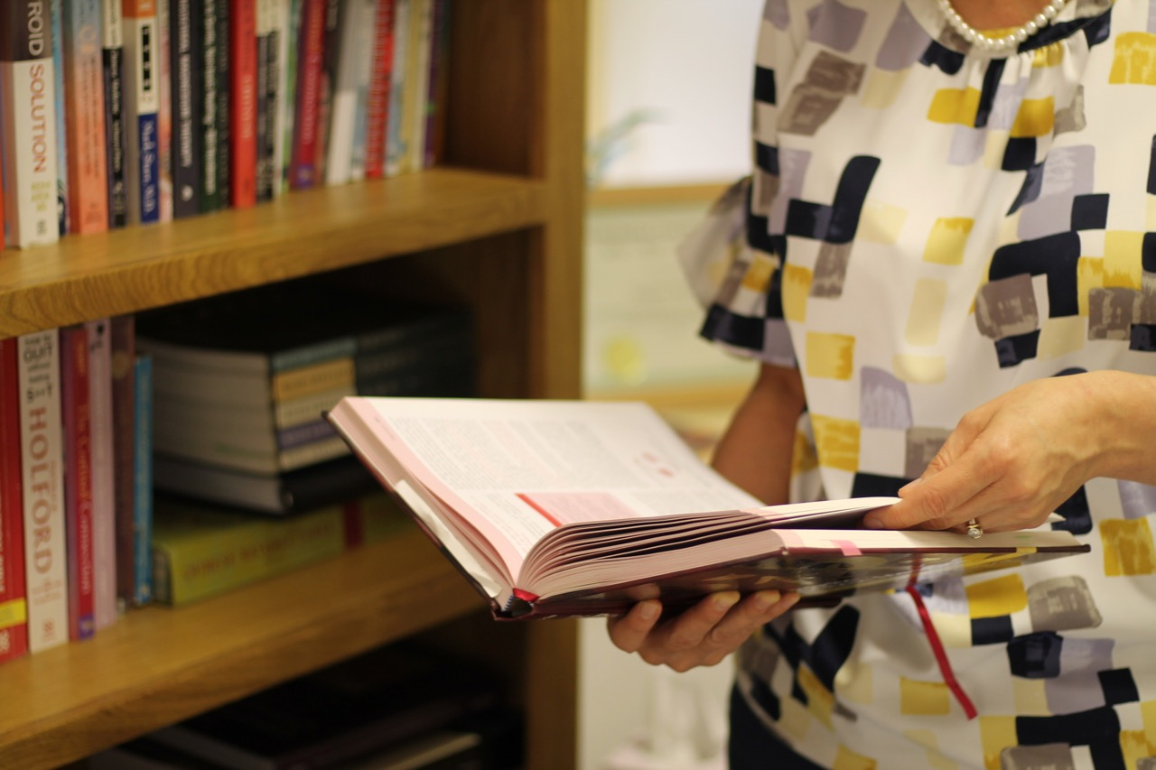 Photo of a lady looking at a book