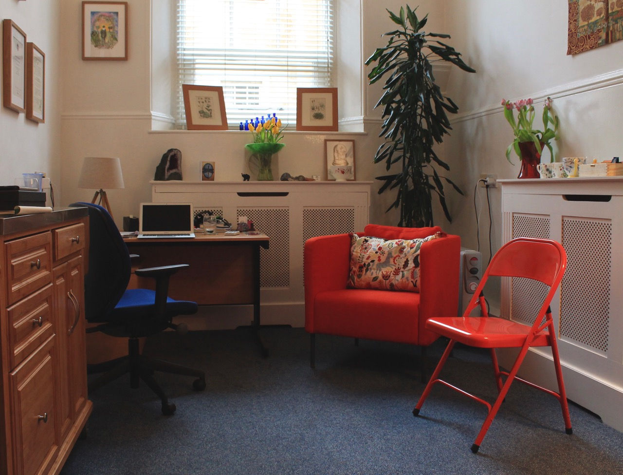 Room interior with bright colours, desk and 2 chairs.